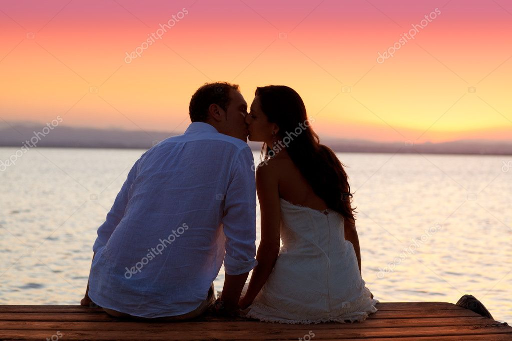 depositphotos_7474718-stock-photo-couple-kissing-at-sunset-sitting